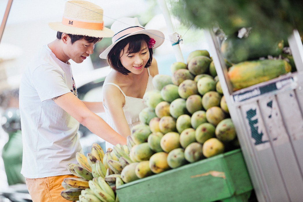 Asian Couple buying fruits on Singles Day