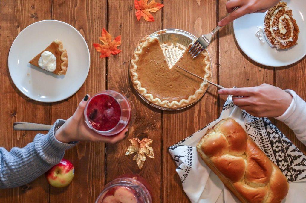 Couple Thanksgiving Dinner Eating Pumpkin Pie