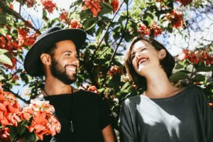 Couple laughing outside nervous
