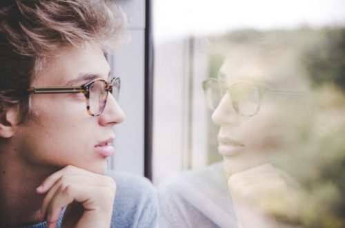 Man thinking looking out of a Window