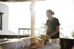 Man getting a massage during vacation