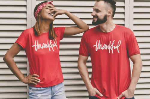 Thankful Couple Smiling wearing red Thankful shirts on their First Thanksgiving