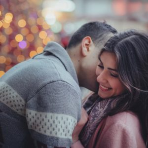 Christmas couple embracing