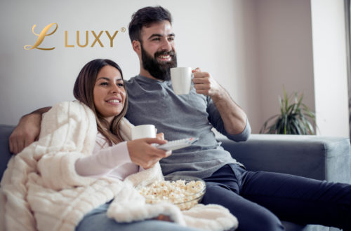 Couple Watching a movie and eating popcorn