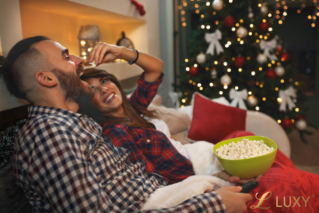 Romantic Couple Watching a Christmas Movie
