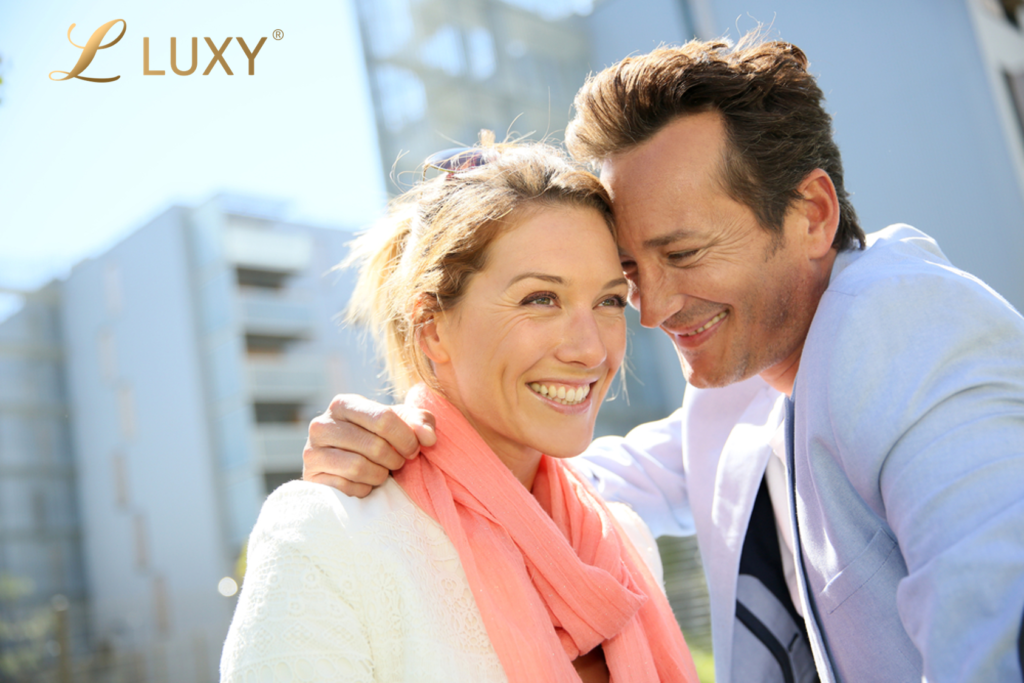 middle age couple exclusive dating on sunny day smiling in a elite dating way