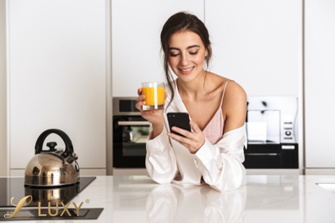 A woman checking her phone and smiling.